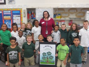 FMFCU Educator Tricia McAllister with Woodlyn Elementary students following a financial education lesson